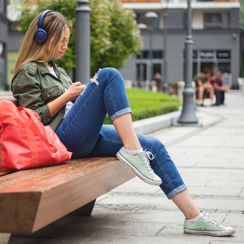 Woman-podcast-listening-outdoors